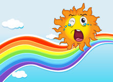 A rainbow and a crying sun Stock Photography