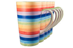 Rainbow cup. Rainbow colored  cup with steam isolated on white Royalty Free Stock Photo