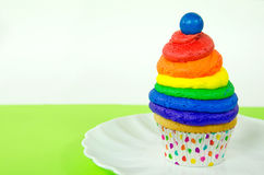Rainbow cupcake with gumball Stock Photography