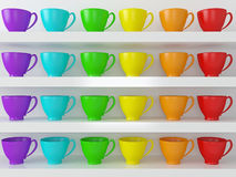 Rainbow cups on the shelfs. Stock Photography