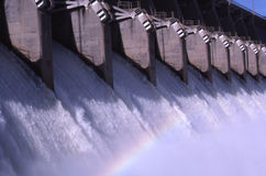 Rainbow in dam spillway. Water pouring through open spillways at eufuala dam on the canadian river in oklahoma stock images