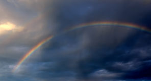 Rainbow in Dark Cloud Royalty Free Stock Photo