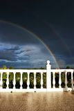Rainbow and dark sky. With sunshine and terrace Royalty Free Stock Images