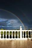 Rainbow and dark sky