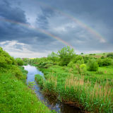 Rainbow in a dark sky Royalty Free Stock Photos