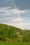 Rainbow in the dark sky. Royalty Free Stock Photo