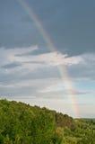 Rainbow in the dark sky. Stock Image