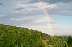 Rainbow in the dark sky. Royalty Free Stock Image