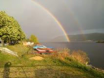 Rainbow and dark tween royalty free stock photo