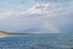 Rainbow at Dead Sea. Rainbow at the Dead Sea, Israel, with hills of Jordan at the background royalty free stock photos