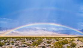 Rainbow on the desert in daylight stock image