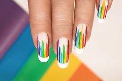 Rainbow design on long oval nails. royalty free stock photography