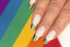 Rainbow design on long oval nails. royalty free stock photos