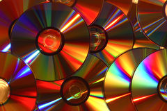 Rainbow discs. Photo of cds with light reflecting off them Royalty Free Stock Photo
