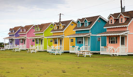Rainbow Doll House Camping Cabins. In Hatteras North Carolina, these doll house looking structures are camping condos for island visitors.  They have become a Royalty Free Stock Photos