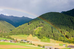 Rainbow in the Dolomites. Beautiful rainbow at Santa Maddalena Valley, Sudtirol (Dolomites, Italy Royalty Free Stock Images