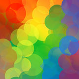 Rainbow Dot Circle Background. Colorful rainbow dots are scattered and clumped together Stock Image