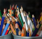 Rainbow Drawing Pencils. A bucket full of multi-colored sharpened drawing pencils Stock Photo