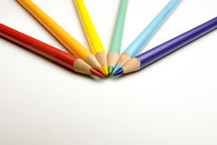 Rainbow drawing pencils with shavings on white. Rainbow colored drawing pencils with shavings on white paper Stock Photos