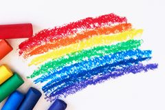 A rainbow drawn with red, orange, yellow, green, blue, indigo, and purple crayons. royalty free stock photo