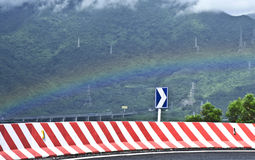 Rainbow and driving direction Stock Photo