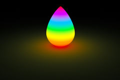 Rainbow droplet glowing in dark color light. Isolated rainbow beautiful ink drop glow on dark background. Colorful spectrum with different hue glowing in the Stock Photo