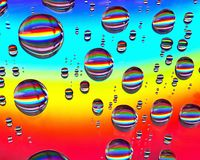 Rainbow drops. Rainbow water drops on CD stock images