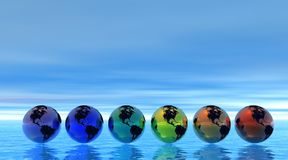 Rainbow earth on sea Stock Photos
