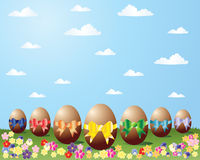 Rainbow easter eggs. An illustration of chocolate easter eggs with rainbow ribbons with a grass and sky background Stock Image