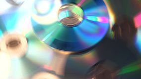 Rainbow effect from pile of CDs disc rotating on black background Stock Image