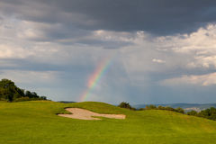 Rainbow on the empty driving range Royalty Free Stock Photos