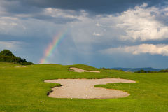 Rainbow on the empty driving range Stock Images