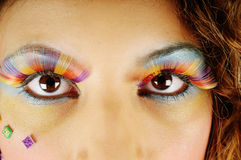 Rainbow eyes. A close up shot of a models eyes, with very bright and colourful makeup Royalty Free Stock Photos