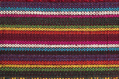 Rainbow fabric detail. Macro of multicolored threads on a fabric from Thailand Stock Image
