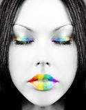 Rainbow face. Girl's face with creative rainbow make-up Stock Photography