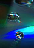 Rainbow factory. Water drops on compact disk royalty free stock images