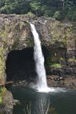 Rainbow Falls in Hilo Hawaii cascading into a peaceful pool stock photo