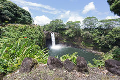 Rainbow Falls and its surroundings Stock Photos