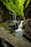 Rainbow Falls Splendor. Located in Watkins Glen NY, this stunning trail takes you through Watkins Glen State Park. There are several styles of waterfalls which royalty free stock image