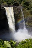 Rainbow Falls Waterfall. Rainbow Falls gushing natural waterfall stock image