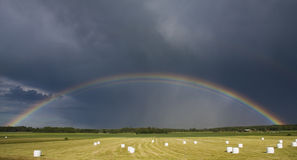 Rainbow in Field. Full length rainbow over farm fields royalty free stock photo