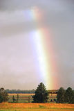 Rainbow in field Royalty Free Stock Photography