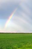 Rainbow in the field Stock Photos