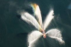 Rainbow in Fire Boat Mist. Aerial view of a beautiful rainbow spray from small fire boat Royalty Free Stock Image