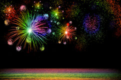 Rainbow Firework celebration on dark background. Stock Photo
