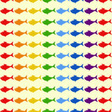 Rainbow fish background. Seamless background with rainbow colored fish isolated on light yellow. For wallpaper, wrapping paper, textile decoration Stock Images