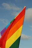 Rainbow flag. On the sky background Royalty Free Stock Photo