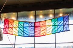 Rainbow Flag Against Window. On Bright Day stock photos