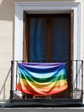Rainbow flag on balcony stock image