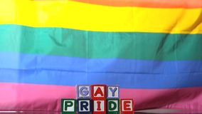 Rainbow flag blowing in the breeze with gay pride blocks Royalty Free Stock Photography